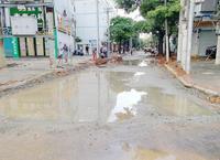 北海天天下大雨,背街小巷9月底能完成吗?